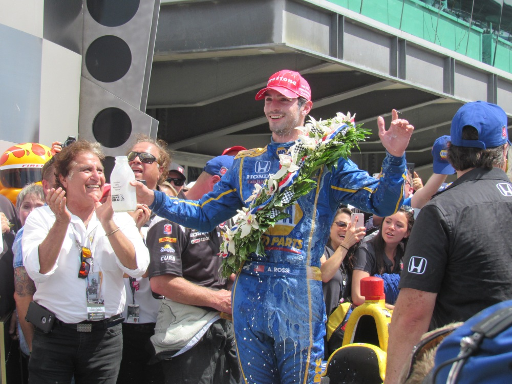By John Jensen/used with permission Alexander Rossi, drenched in traditional cold milk, celebrates his Indy 500 win in the winner's circle.